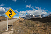 Signs indicate steep curvy roads through the hilly countryside     , Torres del Paine National Park, Magallanes y de la Antartica Chilena, Patagonia, Chile, South America