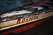 Hand-painted name on a handmade canoe, both in red and black, on a side-arm of the Amazon River, Uara, Amazonas, Brazil, South America