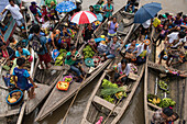 Canoes filled with fruit, souvenirs and other products for bartering dock behind an expedition cruise ship anchored on the Amazon River, Pebas (also Pevas), near Iquitos, Maynas, Peru, South America