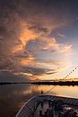 Expedition cruise ship MS Hanseatic (Hapag-Lloyd Cruises) lies at anchor in the late afternoon on the Amazon River, Jutai, Amazonas, Brazil, South America