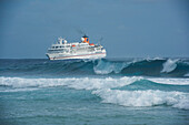 Expedition cruise ship MS Bremen (Hapag-Lloyd Cruises) lies off the coast while passengers go on land, Bock Island, Ujae Atoll, Marshall Islands, South Pacific