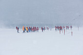 Passengers from a visiting expedition cruise ship brave a blizzard to see the Argentinian Base Orcadas research station, Laurie Island, South Orkney Islands, Antarctica