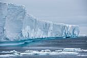 Close-up view of a massive stranded iceberg, rising 20 meters or more above the water's surface, Paulet Island, Antarctic Peninsula, Antarctica