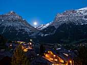 Grindelwald town with Eiger and Schreckhorn mountains in the blue hour, Bernese Oberland, Alps, Switzerland, Europe