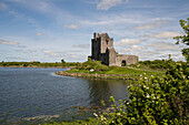 The ruins of Dunguaire Castle sits on the very edge of a bay on the Atlantic Ocean, near Kinvara, County Galway, Ireland, Europe