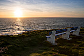A park bench to enjoy the sunset over the Cliffs of Kilkee and the Atlantic Ocean, Kilkee, County Clare, Ireland, Europe
