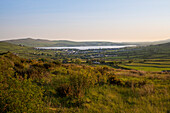 View of Dingle Bay with the city behind at sunset, seen from while walking the Dingle Way, Dingle, Dingle Peninsula, County Kerry, Ireland, Europe