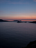 Twilight on Slea Head with a view to the Great Blasket Islands seen from while walking the Dingle Way, Slea Head, Dingle Peninsula, County Kerry, Ireland, Europe