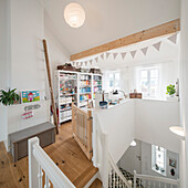 Modern Nordic furnished attic with manual workstation in family house with wooden floor, Korbach, Hesse, Germany, Europe