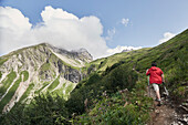 Father and his seventeen year old son crossing the alps from Oberstdorf/Germany-Lechtal-Verwall-Silvretta/all Austria-to Unterengadin/Switzerland and Vinschgau/South Tyrol, Italy,  Finn on the path to the Rappensee Huette on Day1 from the valley in Faiste