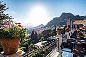 View from the terrace of the Grand Hotel Timeo to the volcano etna and Taormina, Sicily, South Italy, Italy