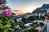 Sunset view from the terrace of the Grand Hotel Timeo to the volcano etna and Taormina, Sicily, South Italy, Italy