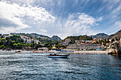 View from the water to Taormina Mare, Sicily, south Italy, Italy