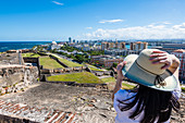 Young woman, view of the old town, Fortress de San Cristóbal, San Juan, Puerto Rico, Caribbean, USA