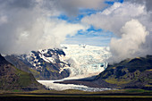 Svinafellsjökull glacier tongue and mountains in Iceland, Europe