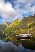 Small boat on Agvatnet lake in Lofotodden national park on Moskenesoya island, Lofoten, Norway, Europe