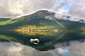 Karikollen mountain, small boat and rainbow in Efjorden, Ofoten, Norway, Europe