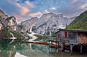 Boathouse on Lake Prags at twilight, Italy, Europe