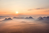 Misty sunrise over the Kleinen Winterberg hill, Saxon Switzerland highlands, Saxony, Germany, Europe