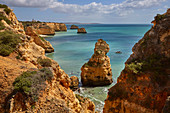 Steep coast at Praia da Marinha beach near Carvoeiro, Atlantic Ocean, District Faro, Region of Algarve, Portugal, Europe
