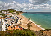 View at the steep coast and beach of Salema, Parque Natural do Sudoeste Alentejano e Costa Vicentina, Atlantic Ocean, District Faro, Region of Algarve, Portugal, Europe