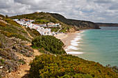 View at the steep coast and beach of Salema, Parque Natural do Sudoeste Alentejano e Costa Vicentina, Atlantic Ocean, District Faro, Region of Algarve, Portugal, Europe
