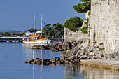 Motor sailing ship in front of the old town of Krk on the island Krk, kvarner bay, Mediterranean Sea, Primorje-Gorski kotar, North Croatia, Croatia, Southern Europe, Europe