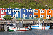 Coloured huts and wodden boats in the harbour, North Sea island Helgoland, Schleswig-Holstein, Northern Germany, Germany, Europe