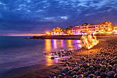 Man juggling with torches at beach of La Playa at night, Valle Gran Rey, La Gomera, Canary Islands, Canaries, Spain