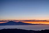 Morning mood above La Gomera with view to Teneriffa with Teide, UNESCO World Heritage Teide, from Mirador del Morro de Agando, National Park Garajonay, La Gomera, Canary Islands, Canaries, Spain