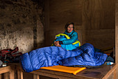 Hiker in Suileag Bothy is waiting for the right weather, Inverpolly Nature Reserve, Highlands, Scotland, UK