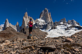 A mountaineer looks out over the Fitz Roy, from Laguna de los Tres, Los Glaciares National Park, Patagonia, Argentina