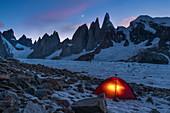 Light in a bivouac in front of Cerro Torre, Circo de los Altares, Los Glaciares National Park, Patagonia, Argentina