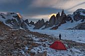 Mountaineer in front of bivouac at Circo de los Altares, Cerro Torre, Los Glaciares National Park, Patagonia, Argentina