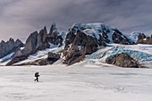 Climber on ice surface of the Campo de Hielo Sur, Cerro Torre in the background, Los Glaciares National Park, Patagonia, Argentina