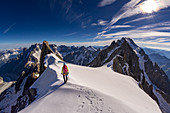 Climbers on the Dome de Rochefort, path to the Grandes Jorasses, Mont Blanc group, France