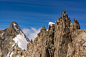 Two climbers in rope team at rock, Rochefort, Mont Blanc group, France