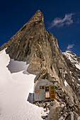 The bivouac Ettore Canzio in front of the Pointe Young, Grandes Jorasses, Mont Blanc group, France