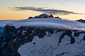 Clouds in front of the Aiguille Verte at dawn, Grandes Jorasses, Mont Blanc group, France