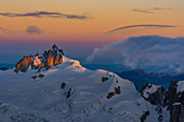 The Aiguille du Midi and glaciers at sunrise, Mont Blanc group, Chamonix, France