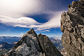 Climber climbing off the rock of Grandes Jorasses, Mont Blanc group, France