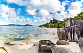 Beautiful young woman relaxing on Anse Source d'Argent beach. La Digue island, Seychelles, Africa
