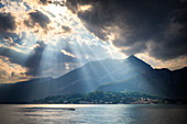 Ray of  sunlight on the lake. Bellagio, Province of Como,  Como Lake, Lombardy, Italy, Europe.