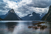 Long Exposure of Milford Sound with low tide on a cloudy summer day. Fiordland NP, Southland district, Southland region, South Island, New Zealand.