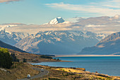 Road alongside Lake Pukaki, looking towards Mt Cook mountain range. Ben Ohau, Mackenzie district, Canterbury region, South Island, New Zealand.