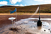 A hot spot with shower and a sink at Hverir, Krafla caldera, Myvatn region, Northern Iceland. Geothermal activity.