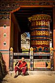 Young monk smiling. Dechen Phodrang Monastery, Thimphu, Bhutan, Himalayan Country, Himalayas, Asia, Asian.