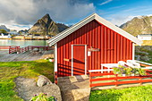 Traditional red cabin on wood deck, Sakrisoy, Reine, Nordland, Lofoten Islands, Norway