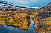 Aerial view of rocky mountains surrounded by sea, Saksun, Streymoy island, Faroe Islands, Denmark