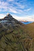 Aerial panoramic of Nestindar mountain peak and road to Trollanes, Kalsoy island, Faroe Islands, Denmark